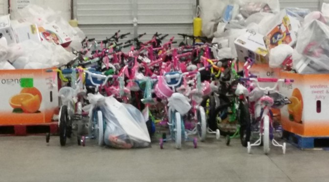 DOZENS OF BRAND NEW BICYCLES TO BE GIVEN AWAY TOMORROW MORNING
